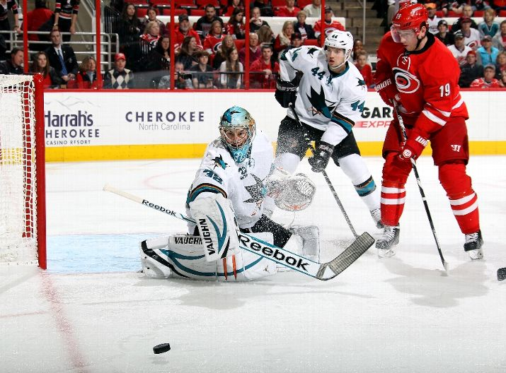 RALEIGH, NC - DECEMBER 06: Jiri Tlusty #19 of the Carolina Hurricanes and Marc-Edouard Vlasic #44 of the San Jose Sharks watch a shot deflect away from Alex Stalock #32 during their NHL game at PNC Arena on December 6, 2013 in Raleigh, North Carolina. (Photo by Gregg Forwerck/NHLI via Getty Images)