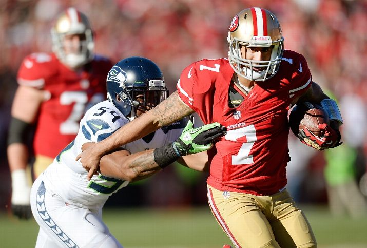 SAN FRANCISCO, CA - DECEMBER 08: Colin Kaepernick #7 of the San Francisco 49ers scrambling with the ball gets grabbed by his jersey from Bobby Wagner #54 of the Seattle Seahawks during the first quarter at Candlestick Park on December 8, 2013 in San Francisco, California. (Photo by Thearon W. Henderson/Getty Images)