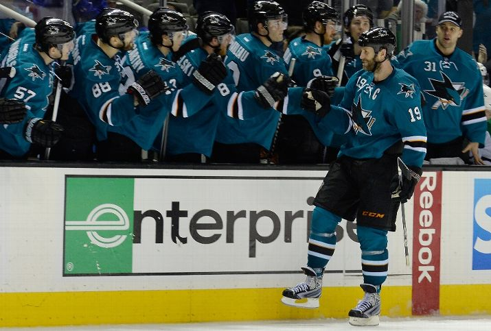 SAN JOSE, CA - DECEMBER 21: Joe Thornton #19 of the San Jose Sharks is congratulated by teammages after he scored the winning goal in an overtime shoot-out against the Dallas Stars at SAP Center on December 21, 2013 in San Jose, California. The Sharks won the game 3-2. (Photo by Thearon W. Henderson/Getty Images)