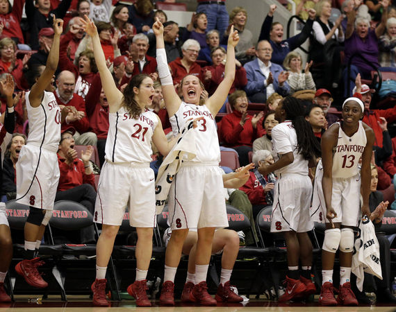 Stanford players celebrate after a score during the second half of an NCAA college basketball game against Oregon, Friday, Jan. 3, 2014, in Stanford, Calif. (AP Photo/Marcio Jose Sanchez)
