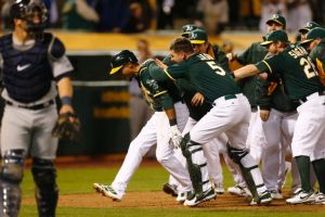 Oakland Athletics center fielder Coco Crisp is congratulated after hitting a walk off home run during the twelfth inning of a baseball game against the Seattle Mariners, Thursday, April 3, 2014, in Oakland, Calif. (AP Photo/Beck Diefenbach)
