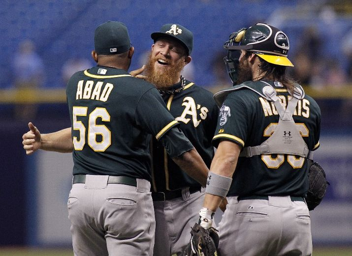 ST. PETERSBURG, FL - MAY 21: Pitcher Sean Doolittle (C) of the Oakland Athletics celebrates his save with teammates Fernando Abad #56 of the Oakland Athletics and catcher Derek Norris #36 of the Oakland Athletics after striking out Wil Myers of the Tampa Bay Rays to end the ninth inning of a game on May 21, 2014 at Tropicana Field in St. Petersburg, Florida. (Photo by Brian Blanco/Getty Images)