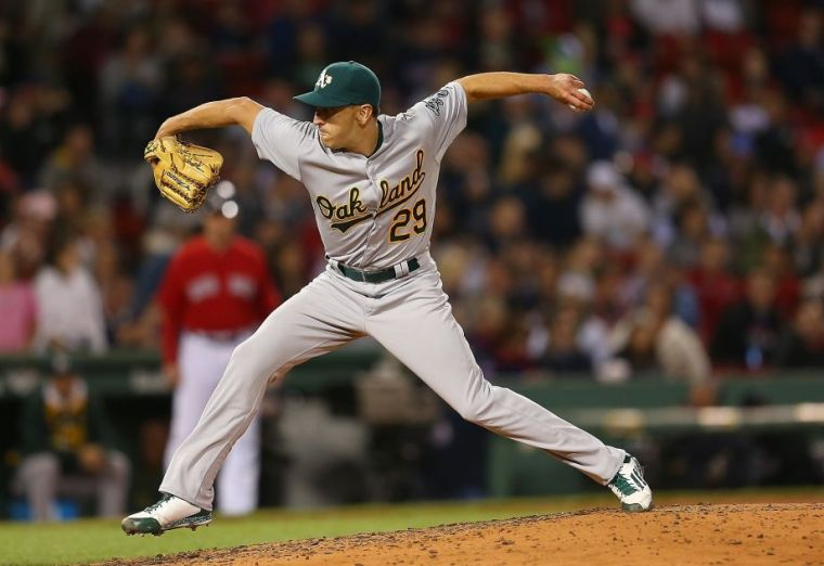 BOSTON, MA - JUNE 5: Pat Venditte #29 of the Oakland Athletics throws on the left side in relief in the seventh inning against the Boston Red Sox at Fenway Park on June 5, 2015 in Boston, Massachusetts. He is a switch-thrower who was called up today from Triple-A Nashville. (Photo by Jim Rogash/Getty Images)