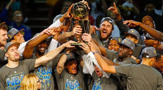 The Golden State Warriors Hold up the NBA Chmpionship Trophy as a Team