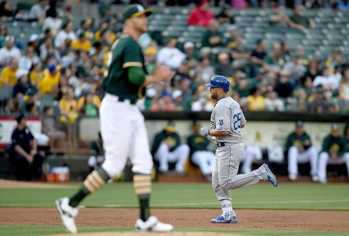 OAKLAND, CA - JUNE 26: Kendrys Morales #25 of the Kansas City Royals trots around the bases after hitting a solo home run off of Jesse Hahn #32 of the Oakland Athletics in the top of the second inning at O.co Coliseum on June 26, 2015 in Oakland, California. (Photo by Thearon W. Henderson/Getty Images)