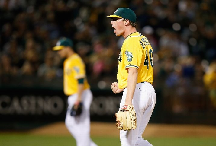 OAKLAND, CA - AUGUST 21: Chris Bassitt #40 of the Oakland Athletics reacts after the Athletics turned a double play to end the fifth inning against the Tampa Bay Rays at O.co Coliseum on August 21, 2015 in Oakland, California. (Photo by Ezra Shaw/Getty Images)