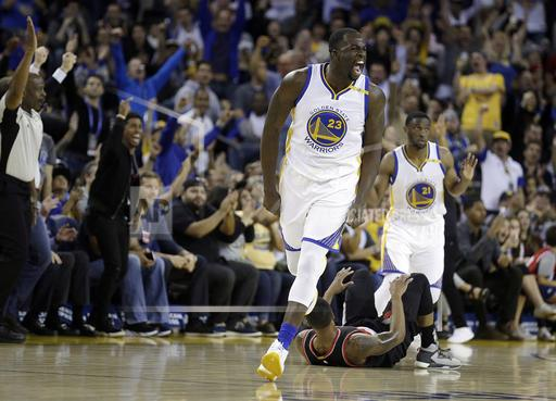 Golden State Warriors' Draymond Green (23) celebrates after a score against the Portland Trail Blazers during the first half of a preseason NBA basketball game Friday, Oct. 21, 2016, in Oakland, Calif. (AP Photo/Ben Margot)